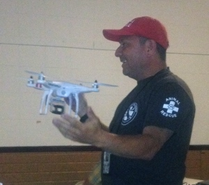 Armando Naverrete from SMART Animal Rescue discussing the benefits of using drones to look for lost animals and plan for potential hazards in a rescue area.